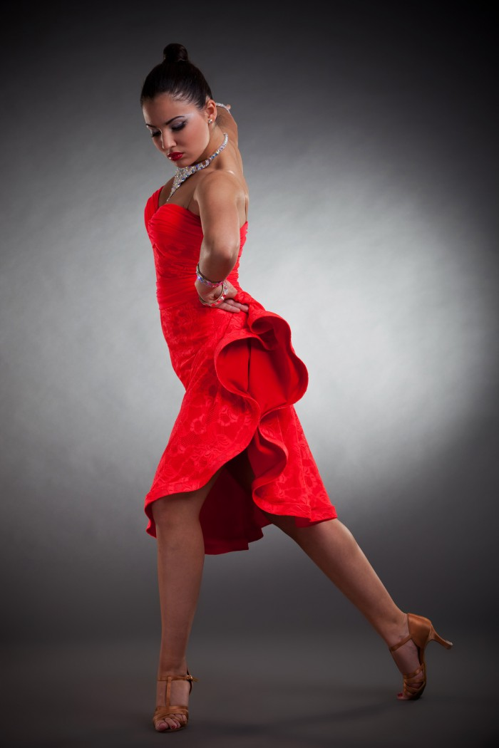 sensual latino dancer posing on dark studio background